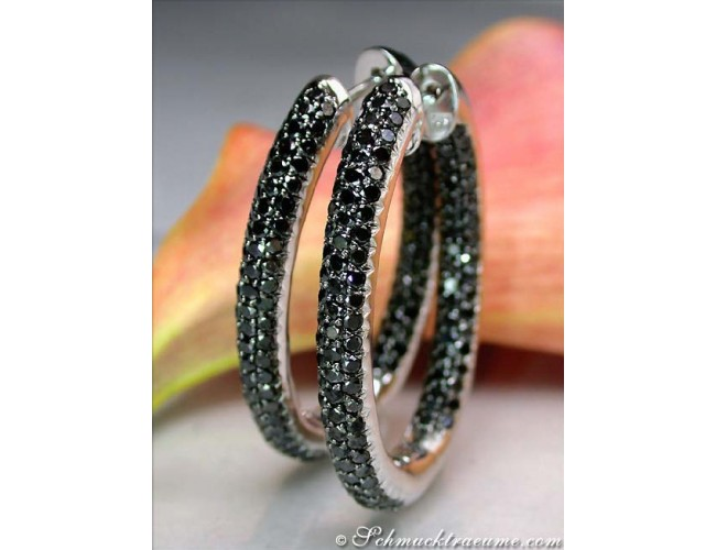 Oval hoop earrings with black diamonds