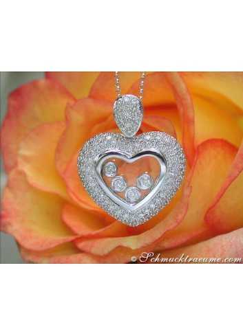 Enchanting Diamond Heart Pendant behind Glass