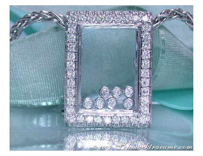 Pretty Diamond Pendant behind Glass